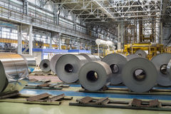 Rolls of aluminum lie in production shop of plant. In special places Royalty Free Stock Photo