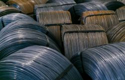 Rolls of aluminum metal fittings steel armature . Heavy industry production. Metal rolling plant Stock Photos