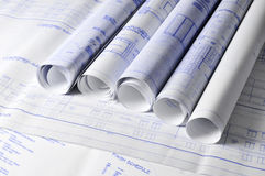 Rolls of architectural blueprins on a table royalty free stock photos