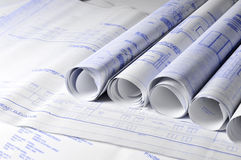 Rolls of architectural blueprins on a table Stock Photo