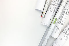 Rolls of architectural blueprints, spirit level, zigzag ruler on Stock Photos