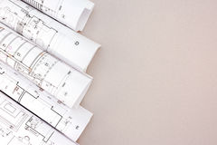 Rolls of architectural blueprints on table Royalty Free Stock Photography
