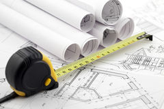 Rolls of architectural blueprints & tape measure Royalty Free Stock Images