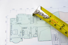 Rolls of architectural house plans & tape measure Royalty Free Stock Photography