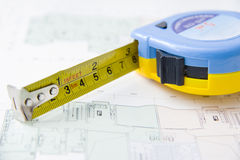 Rolls of architectural house plans & tape measure Royalty Free Stock Image