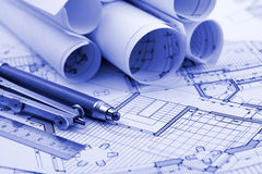 Rolls of architecture blueprint & work tools. Ruler, pencil, compass royalty free stock photo