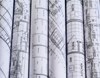 Rolls of architecture blueprints & house plans. background royalty free stock images