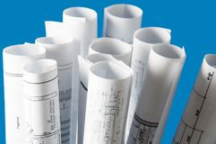 Rolls of architecture blueprints and house plans Stock Images