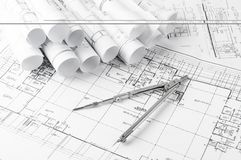 Rolls of architecture blueprints and house plans Royalty Free Stock Photos