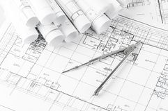 Rolls of architecture blueprints and house plans Royalty Free Stock Image
