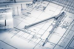 Rolls of architecture blueprints and house plans Stock Photo
