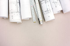 Rolls of architecture blueprints and plan with folding rule on d Stock Photo