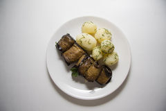 Rolls of aubergines with potato Royalty Free Stock Images
