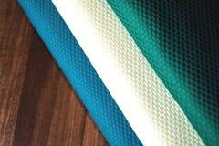 Rolls av färgrikt tyg som en vibrerande bakgrund Royaltyfri Fotografi