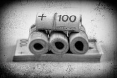 Rolls of banknotes - polish zloty - stylized for old photo. Rolls and stack of banknotes - polish zloty - 100 pln, stylized for old black and white photo Stock Image