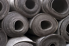 Rolls of black foam Stock Images