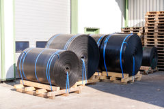 Rolls of black industrial plastic Stock Photos