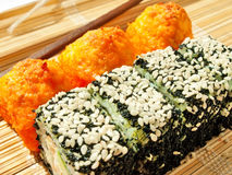 Rolls with black roe and sesame and baking sushi Stock Photo