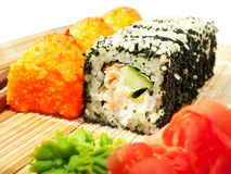 Rolls with black roe and sesame and baking sushi Royalty Free Stock Photography