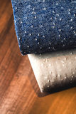Rolls of blue and brown fabric on wooden Stock Image