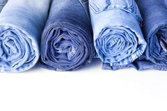 Rolls of Blue Jeans isolated on white background Stock Photo