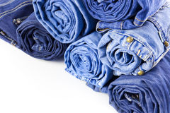 Rolls of Blue Jeans isolated on white background Royalty Free Stock Photo