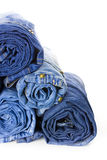 Rolls of Blue Jeans isolated on white background Royalty Free Stock Images