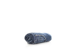 Rolls of blue jeans isolated on white background. Royalty Free Stock Images