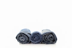 Rolls of blue Jeans  on white background. Stock Photography