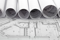 Rolls of blueprint & house plane Stock Photography
