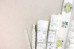 Rolls of blueprints and folding rule with spirit level Stock Photos