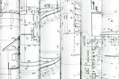 Rolls of blueprints for house construction Royalty Free Stock Images