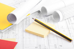 Rolls of blueprints and a pencil Stock Image