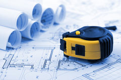 Rolls of blueprints & tape measure Royalty Free Stock Photo