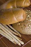 Rolls and bread sticks. Rolls with cereal and bread sticks Stock Image