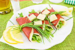Rolls of bresaola, arugula and Parmesan Royalty Free Stock Photos