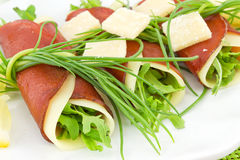 Rolls of bresaola, arugula and Parmesan Stock Images