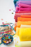 Rolls of bright colored fabric on a white background. Royalty Free Stock Photography