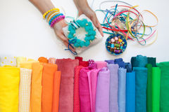 Rolls of bright colored fabric on a white background. Stock Photos