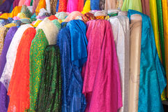 A Rolls of brightly coloured fabrics and cloths. Rolls of brightly coloured fabrics and cloths Stock Image