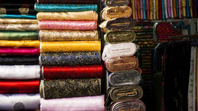 Rolls of brocade in exhibition at shop Stock Photography
