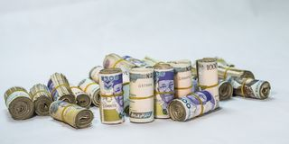 Rolls and Bundles of Naira Cash local currencies  royalty free stock image