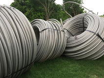 Rolls  of cable on lawn Stock Photo