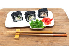 Rolls with caviar, pickled ginger and chuka salad Stock Images