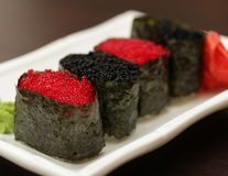 Rolls with caviar Stock Photos