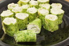 Rolls cheese and mushroom. Appetizer rolls of cheese and mushroom pancakes with spinach Stock Photography