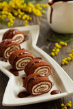 Rolls of chocolate pancakes. With cottage cheese royalty free stock images