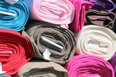 Rolls of Cloth. Rolls of Colorful cloth offered for sale on a market stall Royalty Free Stock Images