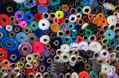 Rolls of cloth on the market. Many rolls with different colors Royalty Free Stock Images