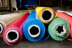 Rolls of cloth at the market. Rolls of cloth on the stall of a street market Stock Photos